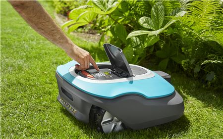 Persons Hand Inserting Pin Into Lawnmower