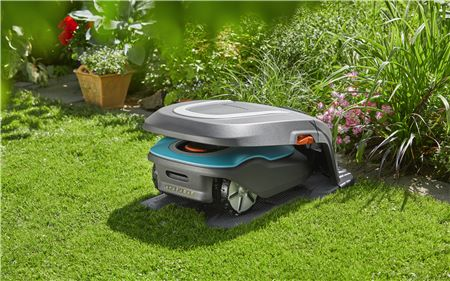 Lawnmower Under Cover In Garden