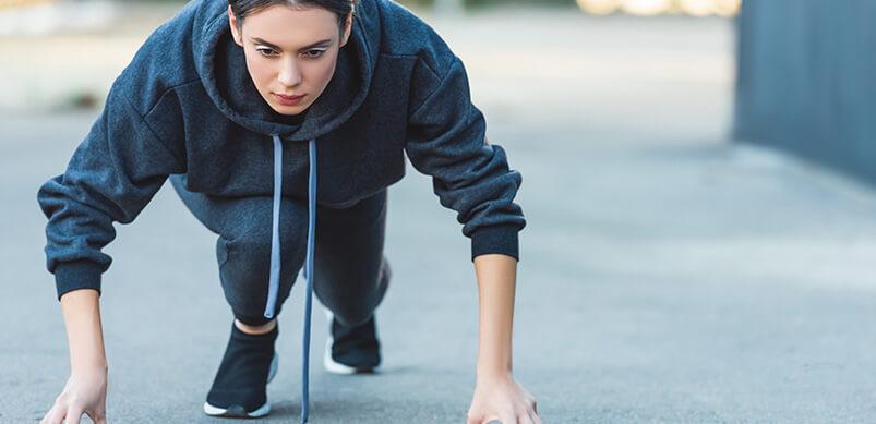 Woman Preparing To Start A Run