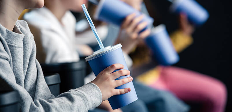 Children Watching Film With Drinks