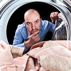 Man Looking Inside Washing Machine
