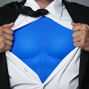 Man Opening Shirt To Reveal Superhero Top
