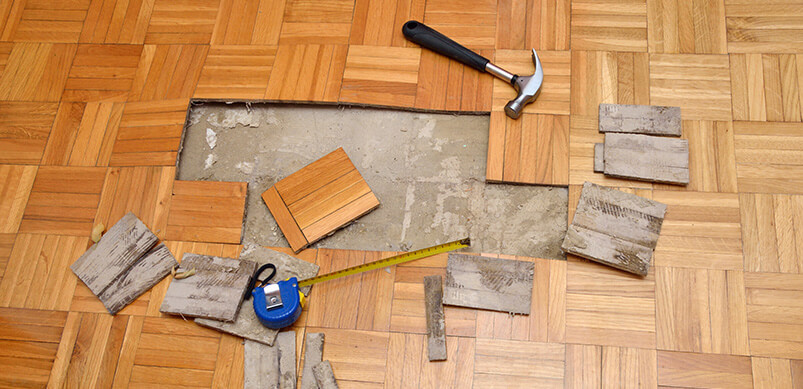 Broken Floor Tiles With Hammer