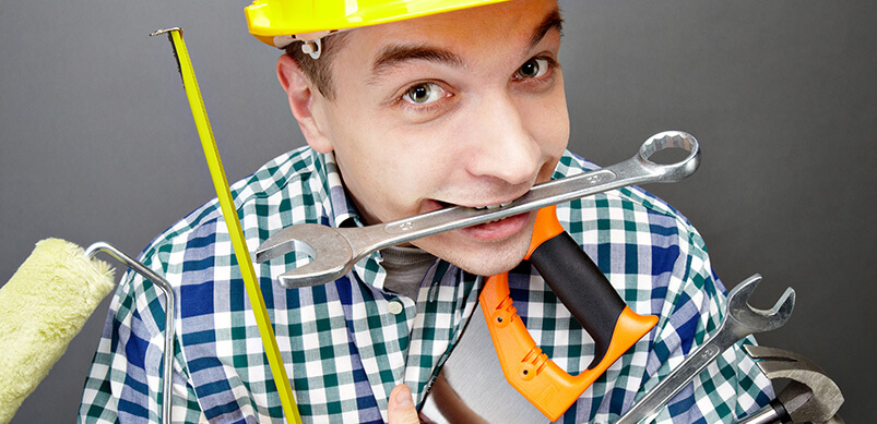 Man Holding Lots Of Tools