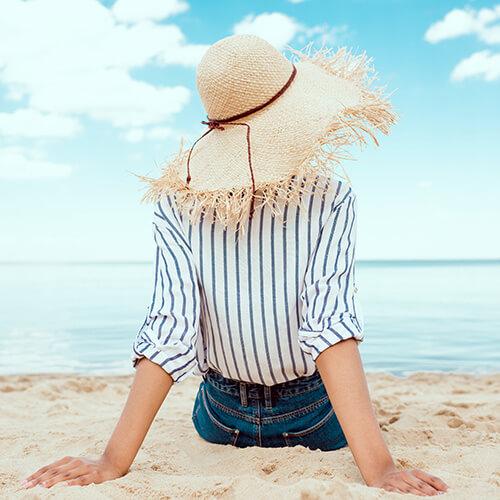 Woman Lying On Beach In Summer