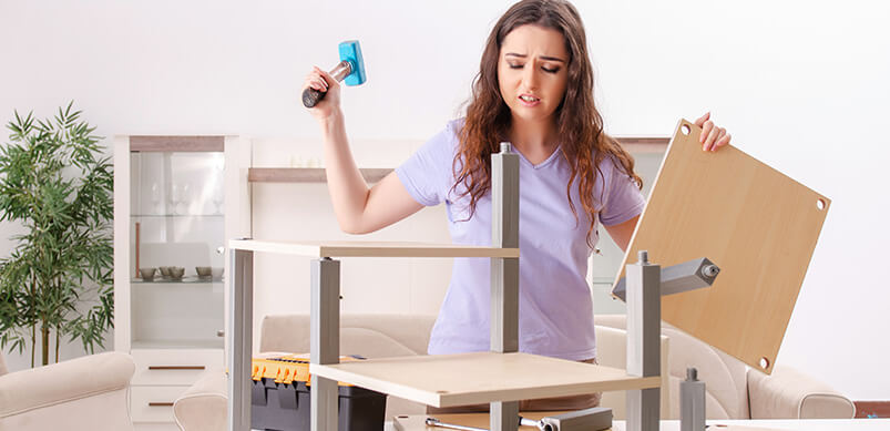 Frustrated Woman Assembling Flat Pack Furniture