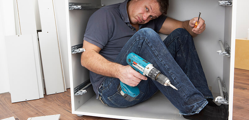 Man Inside Cupboard With Instructions