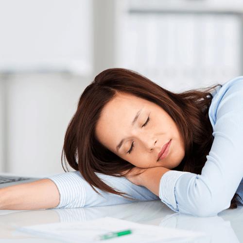 Woman Taking Nap On Desk