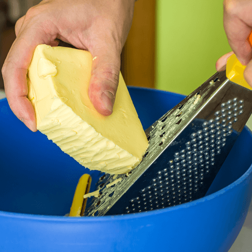 Person Grating Butter
