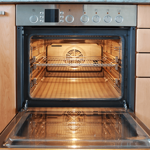 Open Oven With Yellow Glow