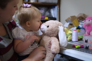 child kissing cuddly toy