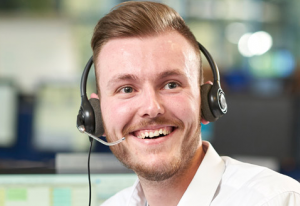 Man with headset smiling