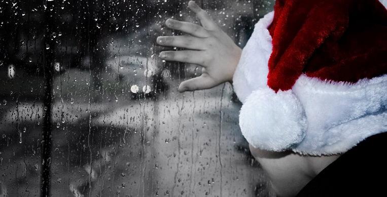 sad child in santa hat