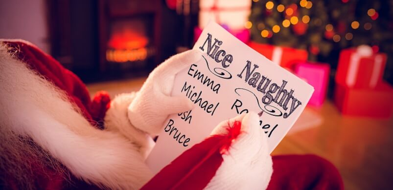 naughty or nice against santa claus writing list with a quill