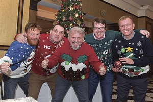 group of men in Christmas jumpers