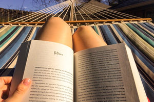 Person in hammock reading book