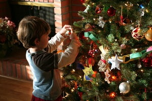 boy decorating tree