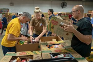 Group of people sorting boxes of food