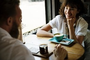 Two people chatting over coffee