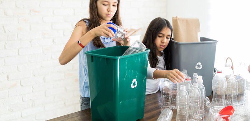 Young Girls Recycling Plastic