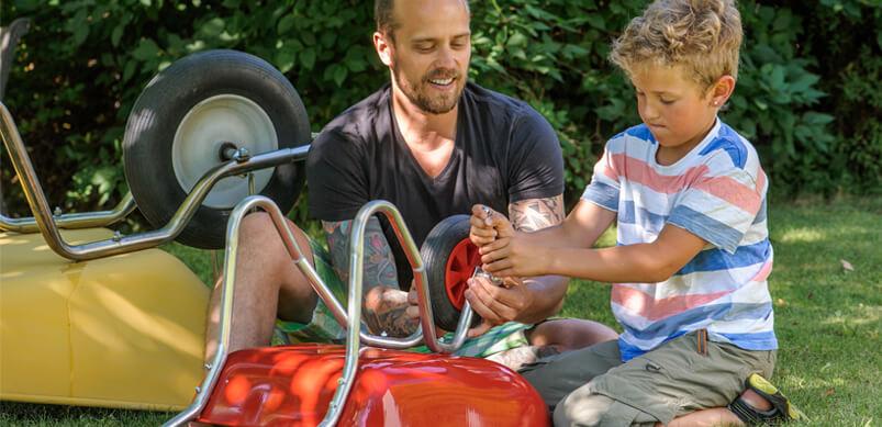 Boy Helping Dad Fix Wheelbarrow