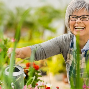 Woman Smiling Doing Gardening