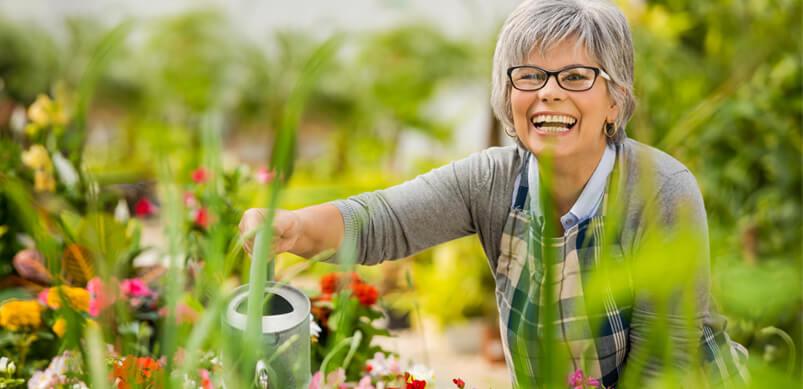 Woman Smiling Doing Gardening