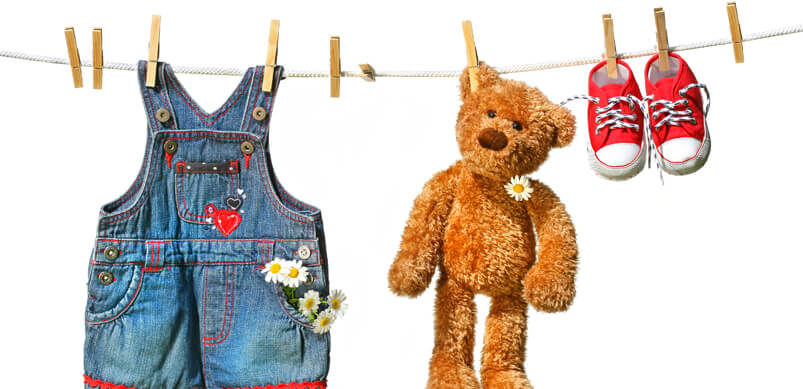 Teddy Bear And Kids Clothing On Washing Line