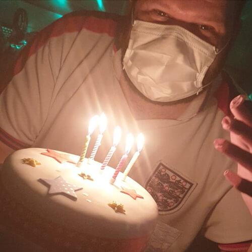 Ad Holding Birthday Cake
