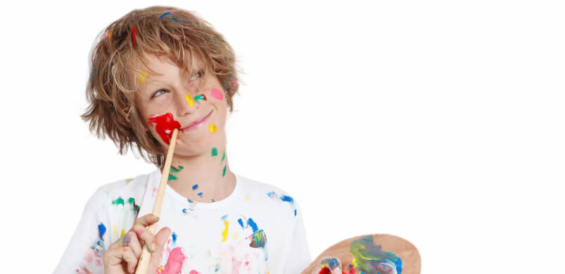 Young Boy With Paint On Face And Shirt