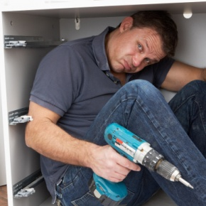 Man Inside DIY Cupboard