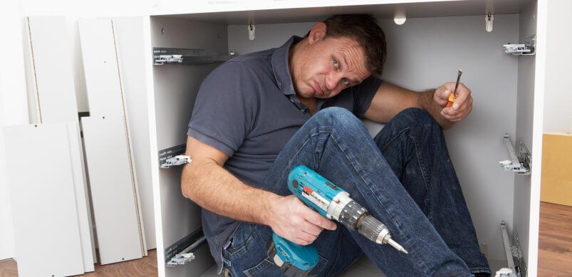 Man Inside DIY Cupboard