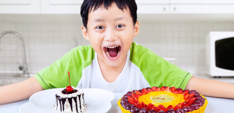 Child Excited With Cakes