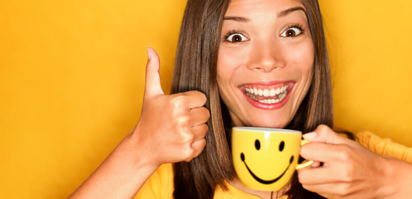 Woman smiling With Cup Of Coffee