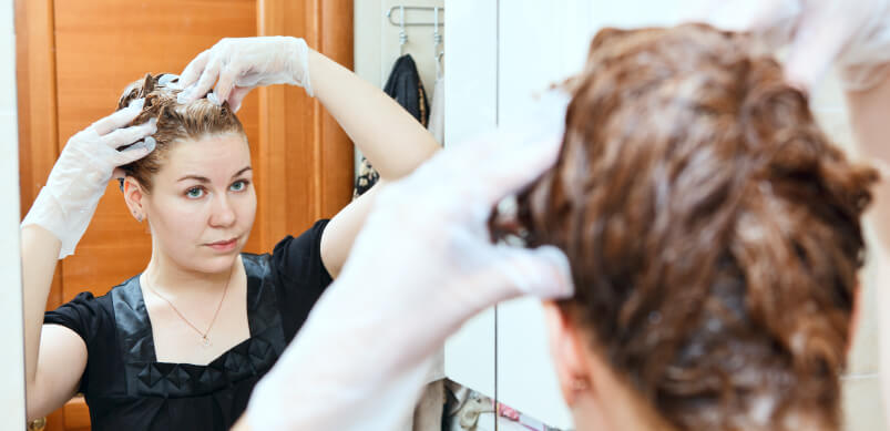 Woman Dying Hair In Mirror