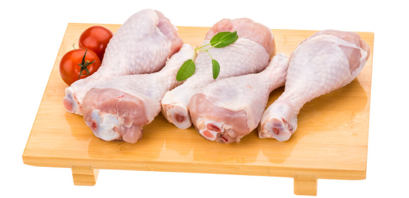 Raw Chicken On Chopping Board