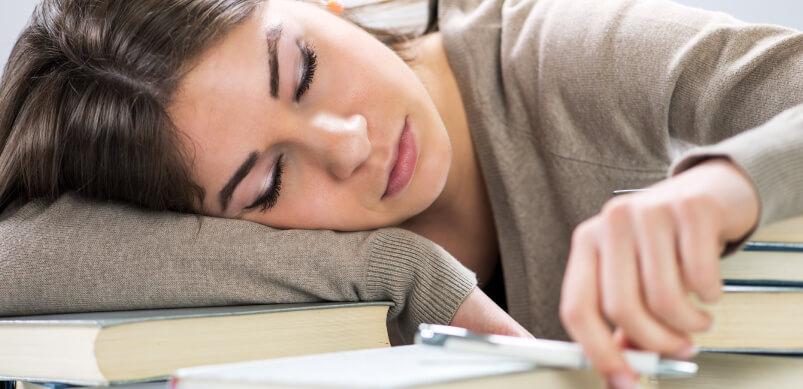 Woman Falling Asleep On Books