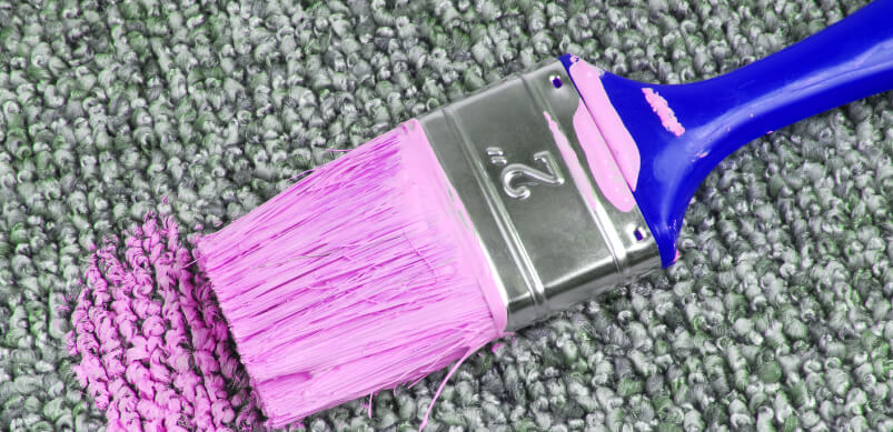 Paint Brush With Pink Paint On Carpet