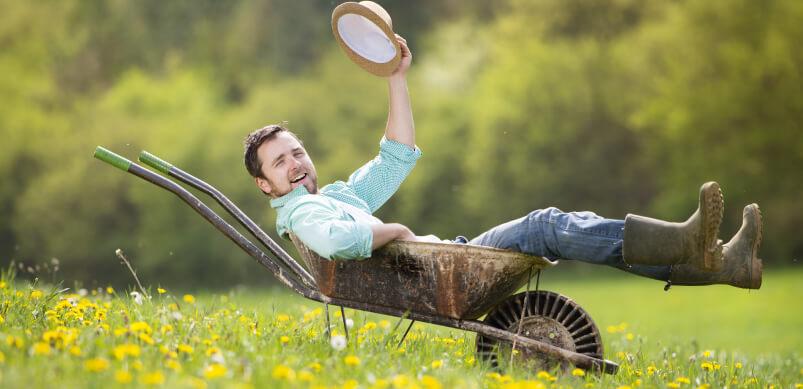Man Sitting In Wheelbarrow
