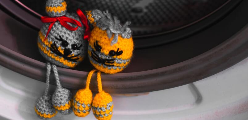 Cute Toys Sitting In Washing Machine