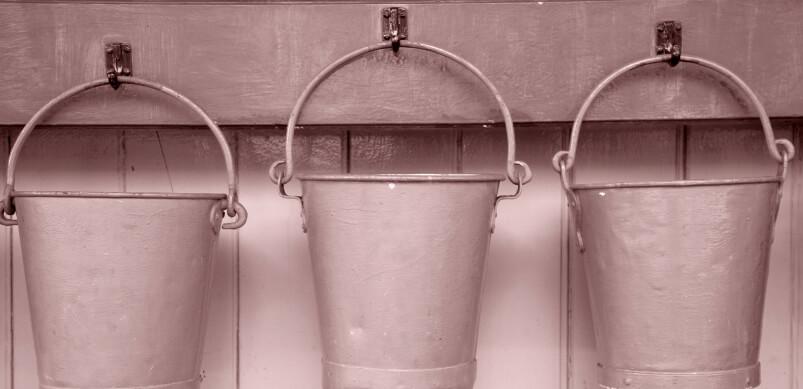 Three Buckets Hanging On Shelf
