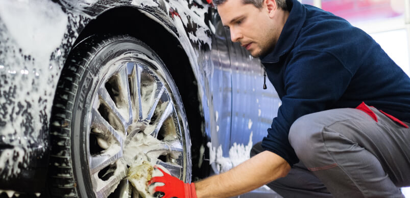 Man Washing Car Wheels