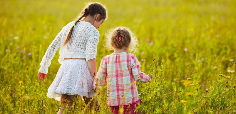 Kids Walking Through Wildflowers