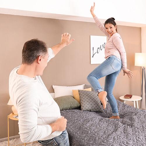 Man And Woman Dancing In Bedroom