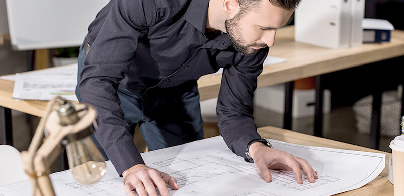 Man Working Out Plan For Project