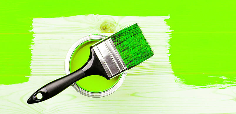 Paintbrush And Unfinished Wall