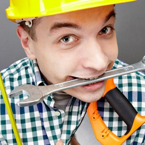 Man Smiling Holding DIY Tools