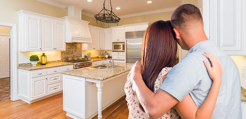 Couple Looking At Kitchen Project