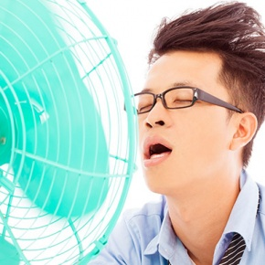 Man Sitting Close To Fan