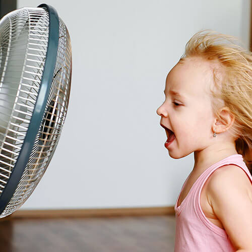 Young Girl Infront Of Fan